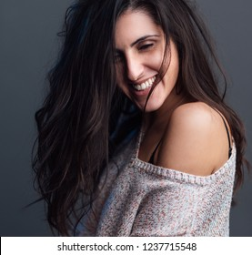 smiling girl on gray background