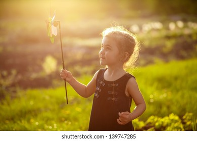 Smiling girl on the meadow with flowers