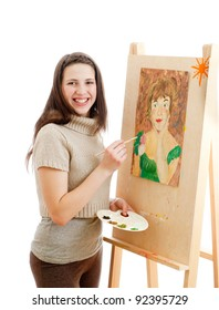 smiling girl painting a picture