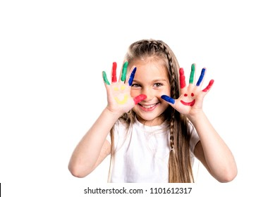 smiling girl with the palms painted by a paint. Isolated on white background
