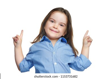 Smiling girl pointing up with fingers