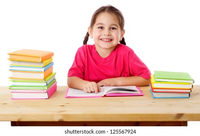 Smiling girl reading the books on the desk, isolated on white