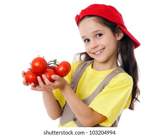Smiling girl in red hat with tomatoes, isolated on white