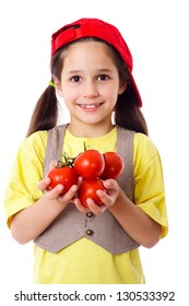 Smiling girl in red hat with tomatoes in hands, isolated on white