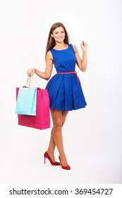 Smiling girl with the shopping bags