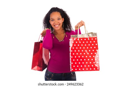 Smiling girl with shopping bags, isolated