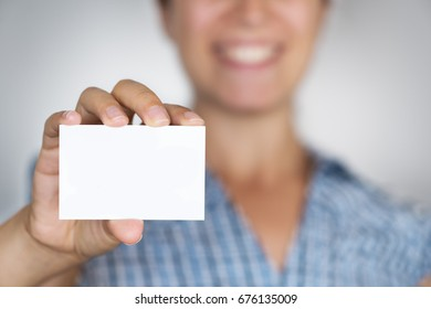 Smiling girl showing business card