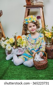 Smiling girl with small white bunny