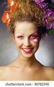 smiling girl with special makeup like butterfly