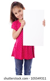 Smiling girl standing with empty vertical blank paper in hands, isolated on white