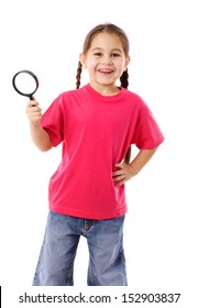 Smiling girl standing with magnifying glass, isolated on white