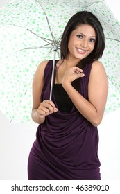 Smiling girl standing with umbrella