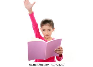 Smiling girl studying