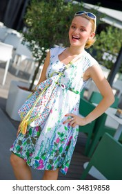 smiling girl in summer dress with bag