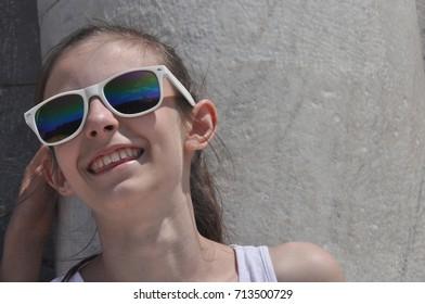 Smiling girl in sunglasses under the Basilica of Pisa