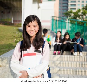 smiling girl Teenage Students standing  at campus