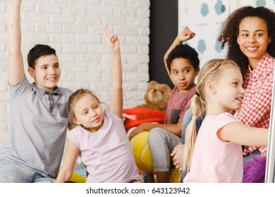 Smiling and girl with thumbs up during language lesson