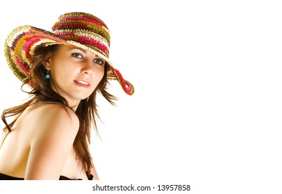 Smiling girl wearing a colorful beach hat; space for text