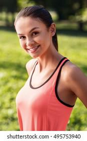 Smiling girl wearing sportswear in the park