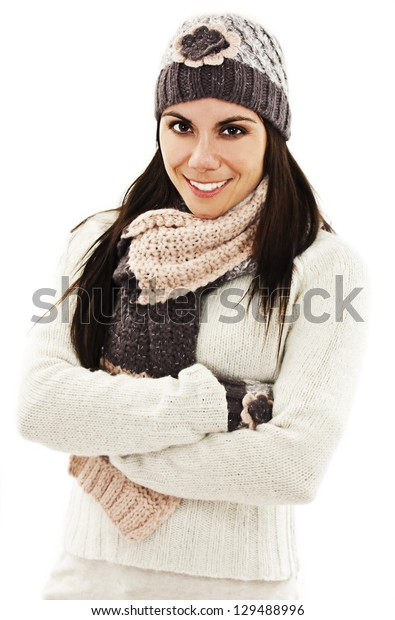 Smiling girl in winter style. Isolated on white background