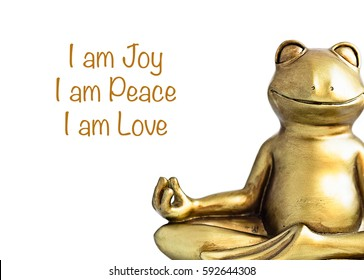 Smiling gold yoga frog meditating in lotus pose. Joy, peace, love quote. Positive affirmations. Isolated on white