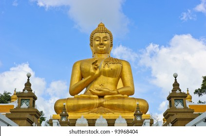Smiling golden Buddha statue in Thailand