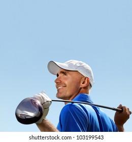 Smiling golfer holding golf club over shoulder