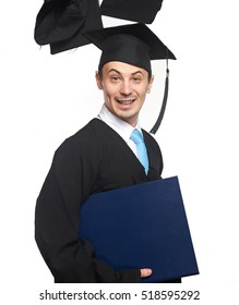 smiling graduating student with flying hats isolated on white background