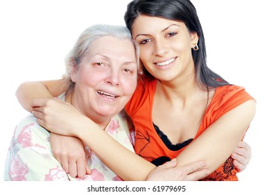 Smiling grandmother and granddaughter embracing,white background ,horizontal