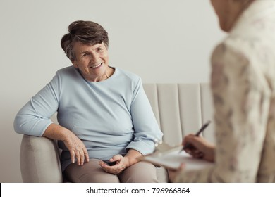 Smiling grandmother talking with her financial counselor about life savings
