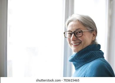 Smiling grandmother wearing glasses