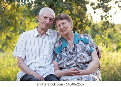 smiling grandparents. portrait of smiling senior man and senior woman at the garden. happy old age