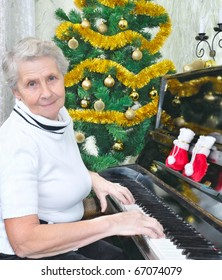 smiling granny play to piano Christmas song