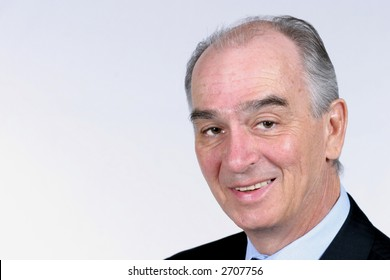 Smiling gray haired man in suit on white background
