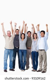 Smiling group of friends giving thumbs up against a white background