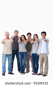 Smiling group giving thumbs up against a white background