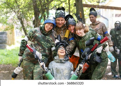Smiling group of paintball players outdoors
