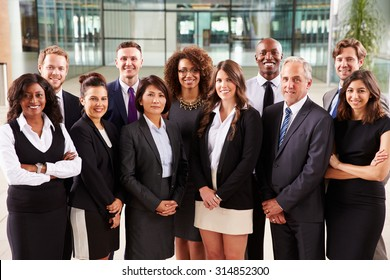 Smiling group portrait of corporate business colleagues