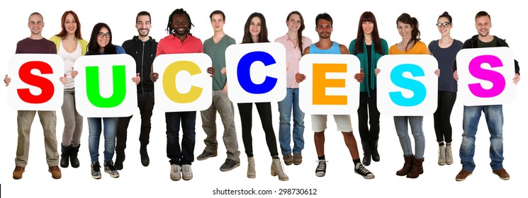 Smiling group of young multi ethnic people holding word success isolated on white