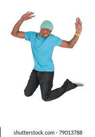 Smiling guy in a blue t-shirt jumping for joy, isolated on white background.
