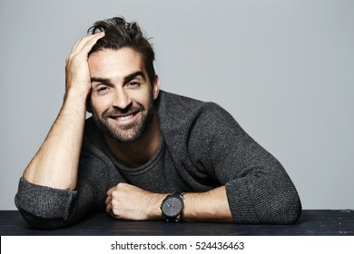 Smiling guy in grey sweater, portrait