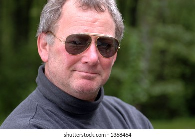 smiling guy wearing classic sunglasses