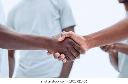 smiling guys shaking hands. isolated on white