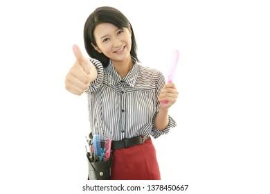 Smiling hairdresser isolated on white background.