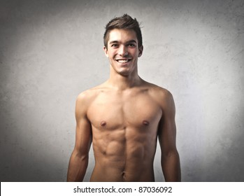 Smiling handsome bare-chested young man