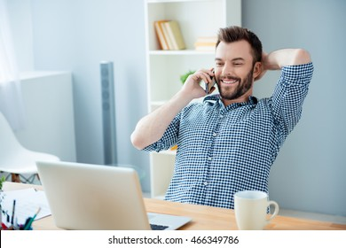 Smiling handsome businessman having talk with his clients