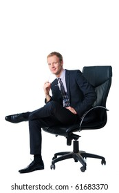 smiling handsome businessman sitting in black office chair over white