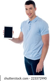 Smiling handsome guy displaying his tablet pc to camera