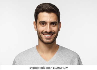 Smiling handsome man isolated on gray background
