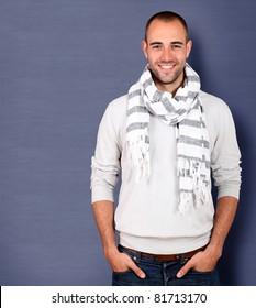 Smiling handsome man wearing scarf